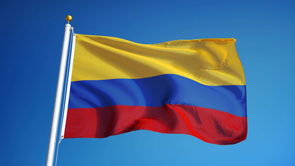 Colombia flag waving against clean blue sky, close up, isolated with clipping path mask alpha channel transparency