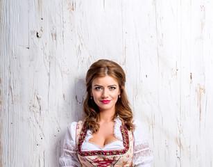 Beautiful woman in traditional bavarian dress, studio shot