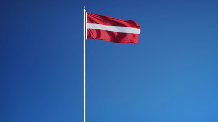 Latvia flag waving against clean blue sky, long shot, isolated with clipping path mask alpha channel transparency