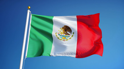 Mexico flag waving against clean blue sky, close up, isolated with clipping path mask alpha channel transparency