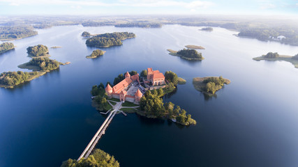 old castle on island in middle of lakes