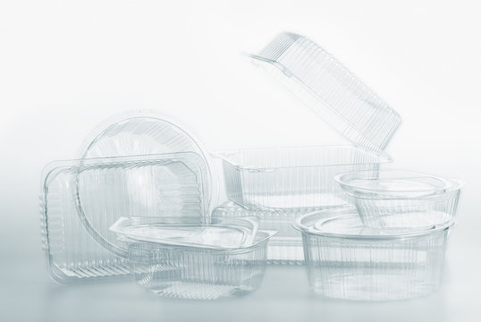 Group of transparent plastic containers box food package on white