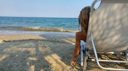 Little girl enjoying on the beach.