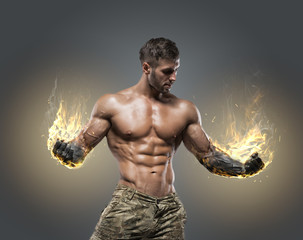 Handsome power athletic man bodybuilder.