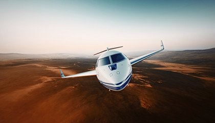 Closeup Front View White Luxury Generic Design Airplane.Private Jet Cruising High Altitude, Flying Over Mountains.Empty Blue Sky with Sun Background. Business Travel Concept. Horizontal. 3D rendering.