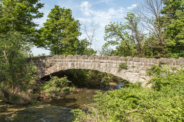 Stone bridge from goat island to three sister island at Niagara Falls State Park in New York, USA.