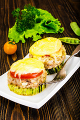 Zucchini with Tuna, Rice, Cheese and Tomato on Barbecue Grill