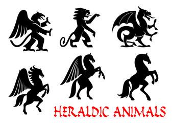 Animals heraldic emblems. Vector silhouette icons