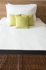Red pillows on white bed