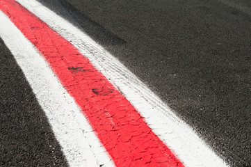 Turning red and white lines on dark grey asphalt