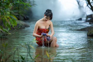 Girl washing in streams, sexy