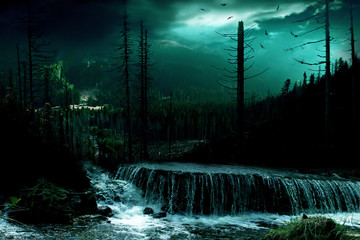 Mountain waterfall in the fairy forest at night.