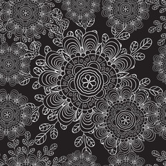 Seamless pattern with doodles elements for design. black and white flowers, leaves