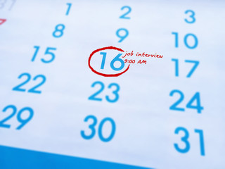 Reminders job Interview at 9 am word written on calendar.Important reminder.