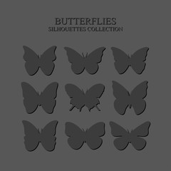 Gray silhouettes of butterflies on a gray background