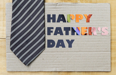 HAPPY Father's day concept design idea on paper background with blue necktie