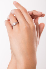 Diamond engagement ring on hand of young woman
