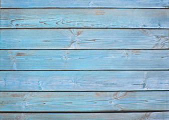 Old wooden fence. blue wood palisade background.