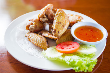 Traditional Thai fired chicken wing close up.