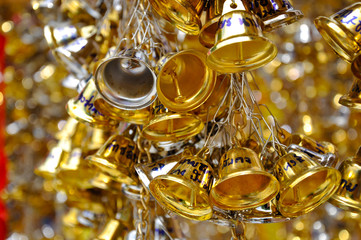 Lucky golden and silver bells with people names are hanging in temple in Thailand. Thai people believed to get lucky and success in doing business.