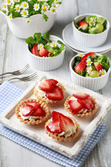 Strawberry cakes and healthy salad