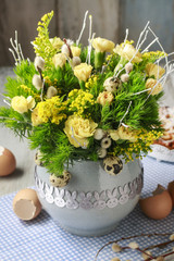 Bouquet of yellow and green carnations in ceramic vase
