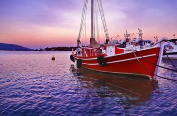 sunset boats at Eretria Euboea Greece - pink sunset background