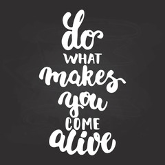Do what makes you come alive - hand drawn lettering phrase isolated on the chalkboard background. Fun brush ink inscription for photo overlays, greeting card or t-shirt print, poster design