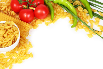 Wall Mural - Different types of raw Italian pasta with tomatoes and other vegetables. Top view background. Copy space