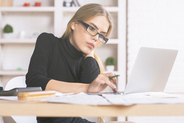 Businesslady using laptop at desk