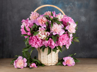 Beautiful peonies in a basket