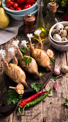 Fresh organic quails on vintage wooden table, healthy food