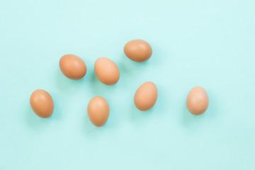 Chicken eggs on blue background.