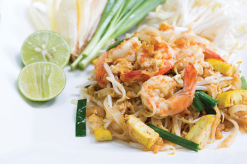 Thai fried noodle with fresh prawn in white dish, thai food (Pad