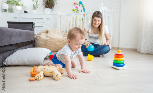 cute 10 months old baby playing on floor with colorful toys imagens e fotos de stock royalty. Black Bedroom Furniture Sets. Home Design Ideas