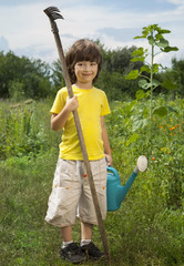 boy with a carrot and a watering can