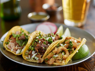 Wall Mural - plate of mexican street tacos garnished with cilantro and onion