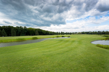 View on golf course at cold day with rainy clouds