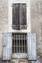 open and closed window shutters in rural France