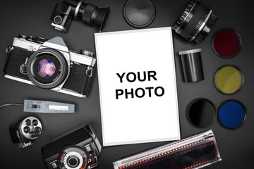 Analog SLR camera equipment around a printed photo (copy-space to insert your image) - All the logos, brand, or anything that can bring to a particular object has been deleted to be 100% commercial