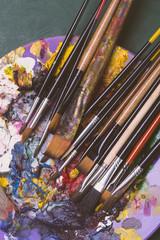 Paintbrushes on artist's palette