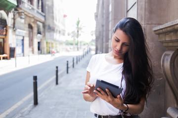 Gorgeous female tourist using digital tablet computer for navigation