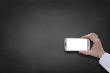 Holding smart phone front on blackboard