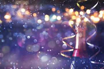Abstract image of champagne bottle and festive lights