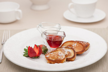 breakfast served with toast with strawberries and milk
