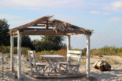 Incredible Small Wooden Gazebo With A Table And Two Benches On The Ibusinesslaw Wood Chair Design Ideas Ibusinesslaworg