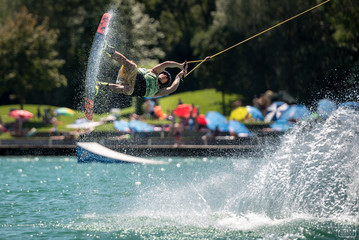 Wakeboarder flying and splashing Wall mural