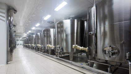 Wine cisterns under temperature control in winery