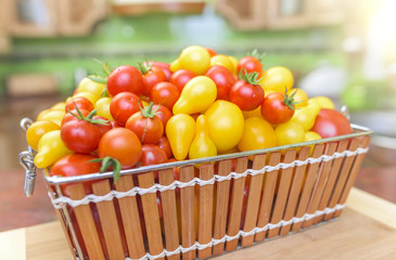 Tomatoes in a basket in the kitchen.