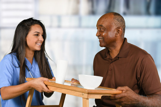 Health Care Worker and Elderly Patient Eating